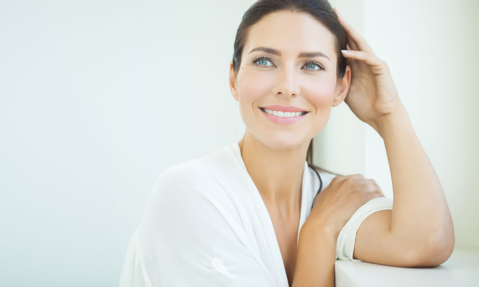 Elevation Med Spa Lone Tree Colorado middle aged woman smiling getting ready for skin treatment